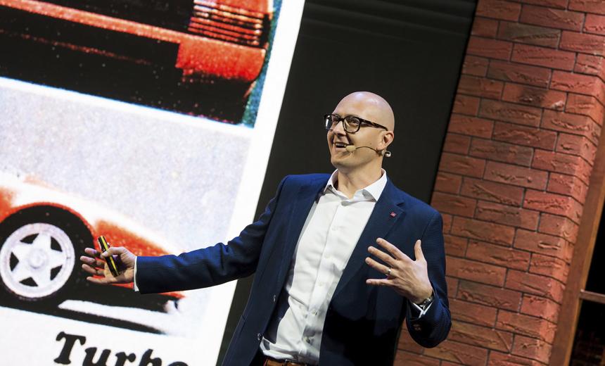 Aurimas gives a presentation at Devbridge Kickoff 2018